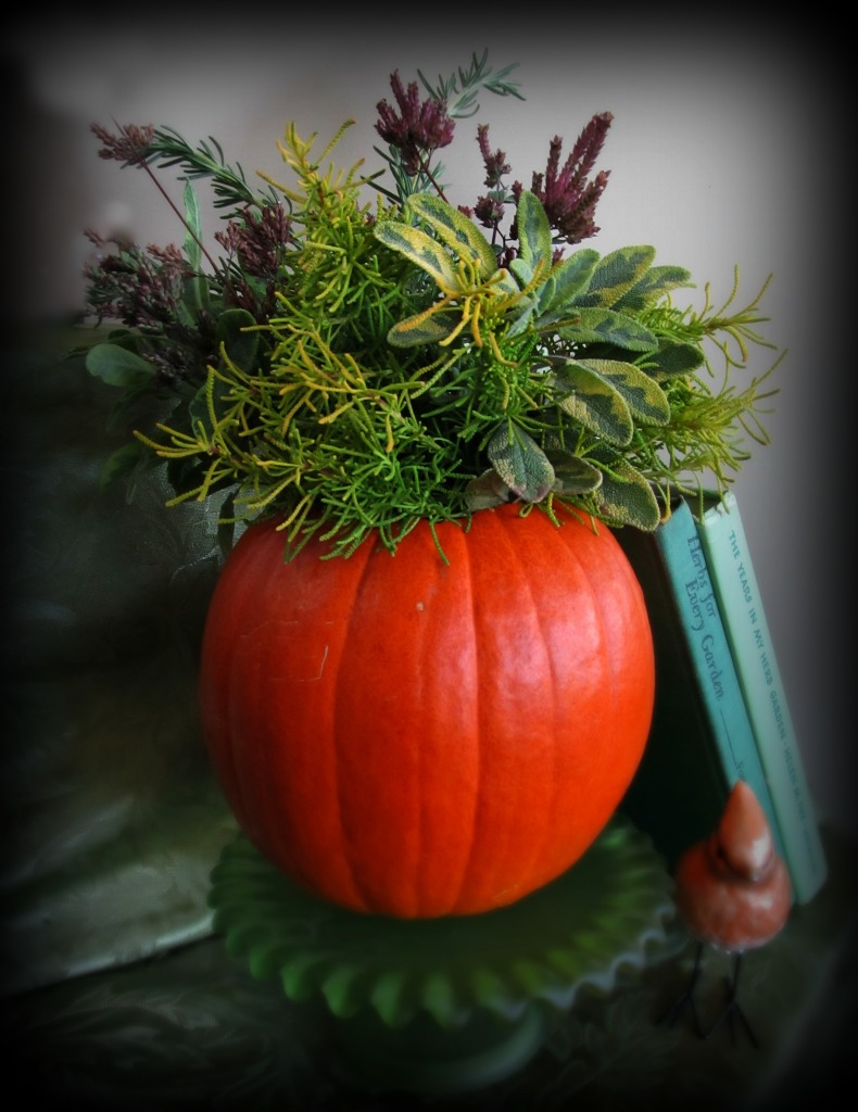 A fresh-cut herb bouquet for fall: 'Lemon Fizz' Santolina, rosemary, golden sage and the dried flowers of 'Rossenkuppel' oregano.